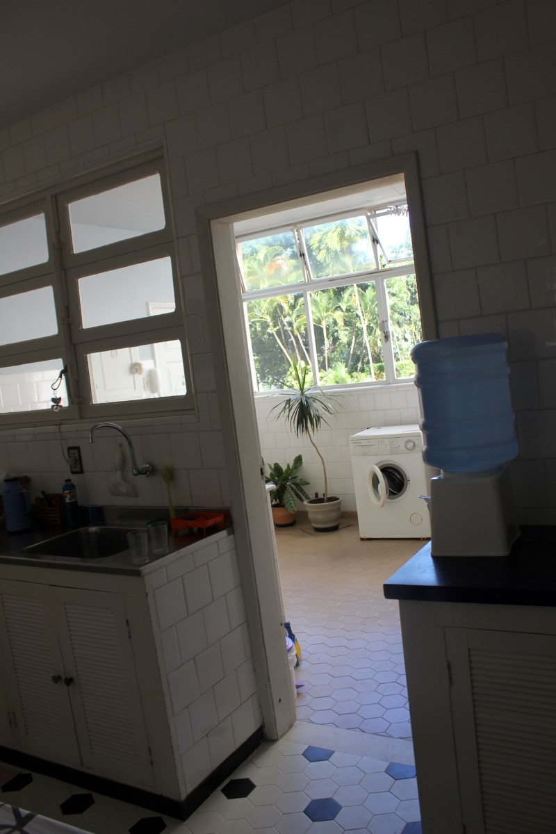 Kitchen leading into a space that has washer and plants...I don't know what this space is besides a back room.