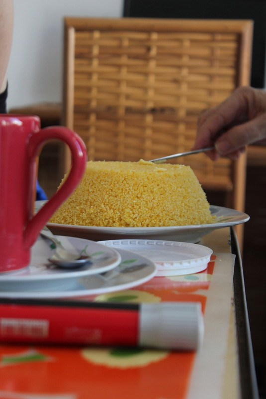 this is a corn meal type breakfast dish...forgot the name. so much for the lesson. update:  it's couscous de milho!  Thanks Kristen :)
